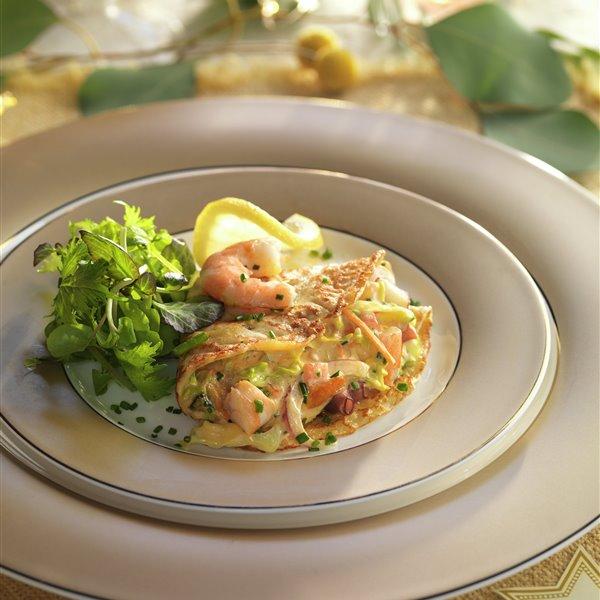 Crepes rellenas de marisco (langostinos, pulpo y mejillones)